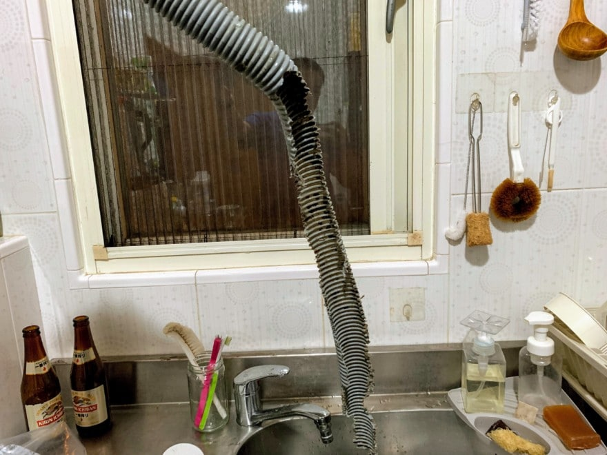 A vacuum next to a sink
